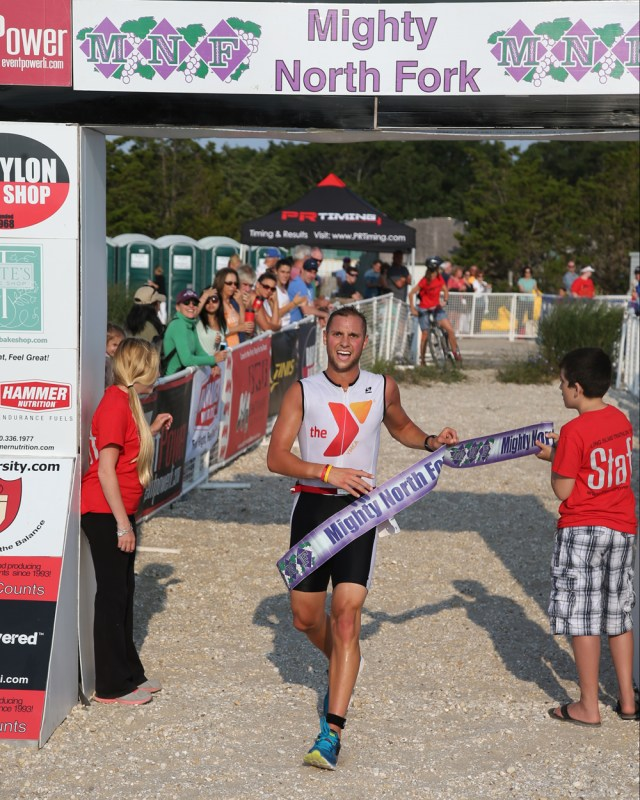 Tim Steiskal of Brookhaven was the winner of the Mighty North Fork Triathlon with a time of 46:36. The event was held at Cedar Beach in Southold Sunday. (Credit: Daniel De Mato)