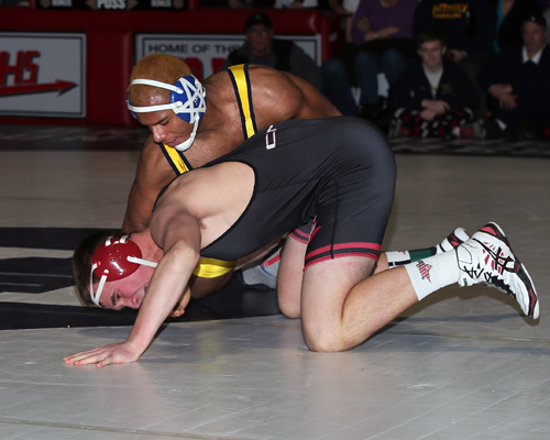 Adam Goode of Mattituck defeated William Hamilton of Center Moriches in the 195 Lbs weight class. The Suffolk County Division II wrestling championships were held at  Center Moriches High School on Feb. 15, 2014. (Photo credit: Daniel De Mato)