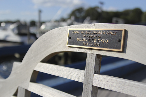 A memorial bench was dedicated to Dominic Trionfo last summer at Strong's Marina in Mattituck. (Credit: Jen Nuzzo)