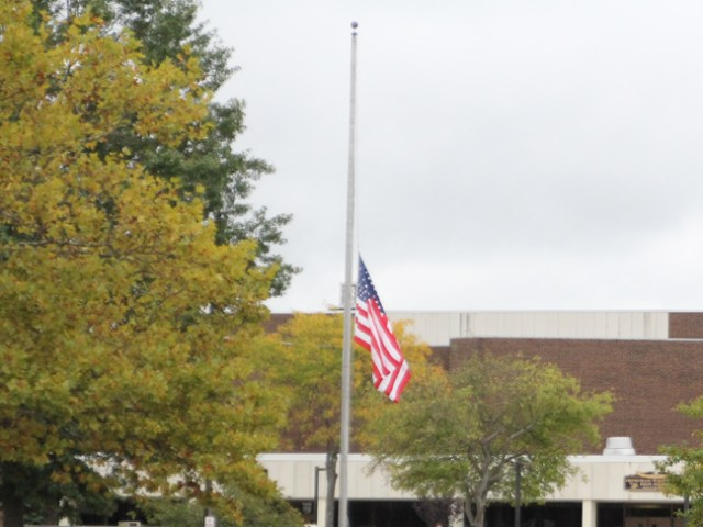 A flag flies at half-mast at Shoreham-Wading River High School last week following the death of junior Tom Cutinella. (Credit: Jen Nuzzo)
