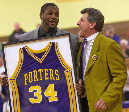 GARRET MEADE PHOTO | Ryan Creighton, holding his retired No. 34 jersey, sharing a laugh with the Greenport school superintendent, Michael Comanda.