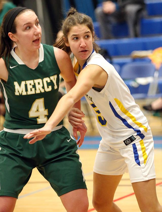 Mattituck's Jane DiGregorio tries to defend Mercy