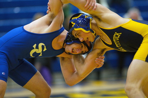GARRET MEADE PHOTO  |  Matt Migliore of Smithtown Christian, left, and Christian Angelson of Mattituck/Greenport locked horns at 152 pounds. Migliore won, 6-3.