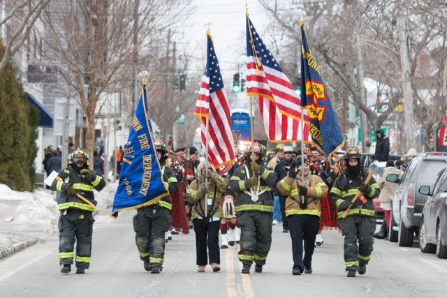 Firefighters march in Saturday's parade in Greenport. (Credit: Katharine Schroeder)