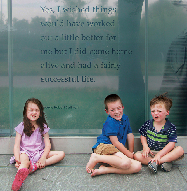 George Sullivan's daughter, Megan Collins, took her three children (from left) Mallaigh, 4, Kevin, 7, and Ryan, 3, to Washington, D.C. to see their grandfather's quote. (Credit: Courtesy photo)