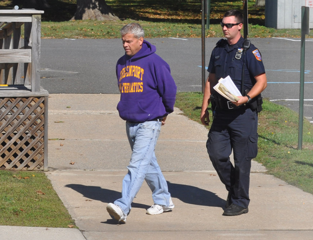 Gordon Haas is led into Southold Town Justice Court Sunday morning. (Credit: Grant Parpan)