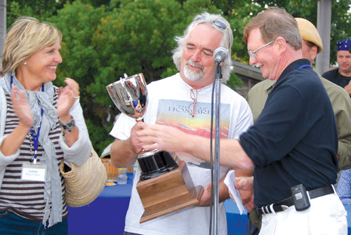 JAY WEBSTER PHOTO | A Mano's chef Tom Schaudel accepts the trophy for Best in Show from chef John Ross as judge Paula Croteau looks on at the 2010 Maritime Festival.