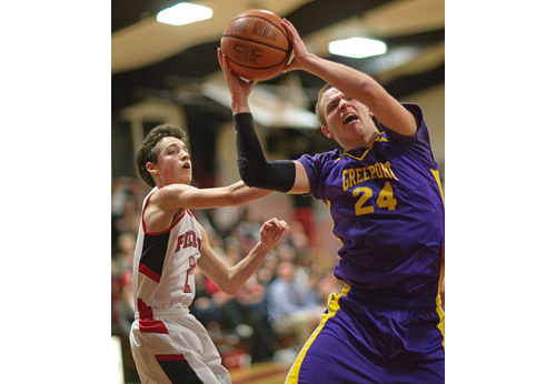 GARRET MEADE PHOTO | Greenport's Austin Hooks, who got into early foul trouble, maneuvering near Pierson's Ian Barrett under the basket.