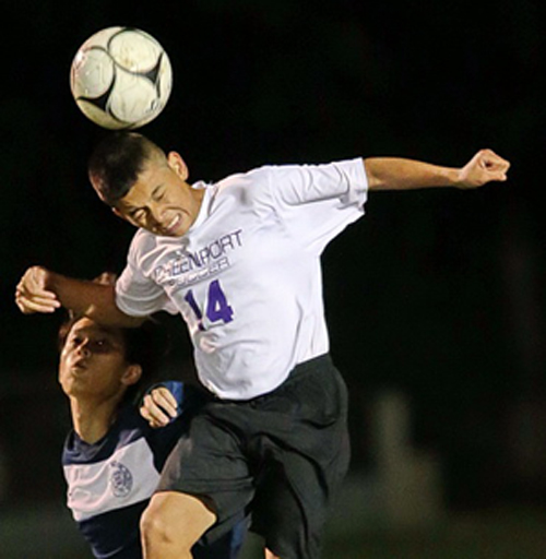 Greenport's Cristian Lopez rises above Stony Brook's Jong Hyun Choi to head the ball during Friday night's game. (Credit: Garret Meade)