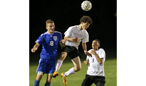 From left, Smithtown Christian's Timothy Voisich and Greenport's Robert Nickolas and Angel Colon in action during Friday night's game. {Credit: Garret Meade)
