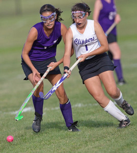GARRET MEADE PHOTO | Port Jefferson's Chiara Rabenno, left, and Greenport/Southold's Gina Seas going shoulder to shoulder in pursuit of the ball.