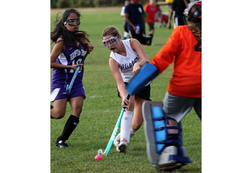Greenport/Southold freshman Madison Hilton pushing the ball forward and closing in on Hampton Bays goalie Ashlyn Von Bartheld. (Credit: Garret Meade)