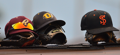 ROBERT O'ROURK PHOTO | The caps of the Riverhead Tomcats, the North Fork Ospreys and the Shelter Island Bucks on top of the North All Stars dugout. For one game, representatives of those teams were teammates.