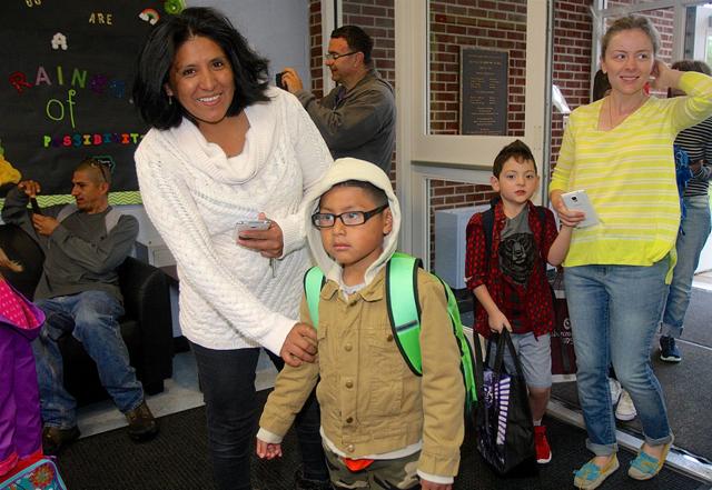 Janet Reninoso arrives with her son Christopher, 6, a kindergartner.