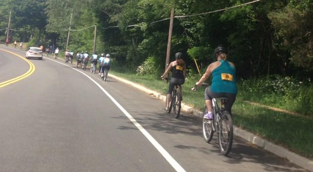 Cyclists ride along Main Road in Southold. (Credit: Joseph Pinciaro)