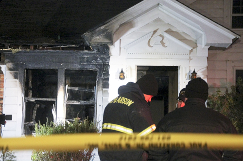 PAUL SQUIRE PHOTO | Officials with the Suffolk County Arson Squad begin their investigation of a fatal house fire in Greenport Wednesday night.