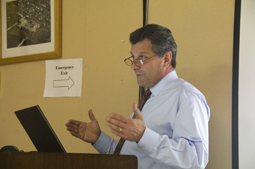 Superintendent Michael Comanda presents to the Greenport school board at its meeting Tuesday night. (Credit: Paul Squire)