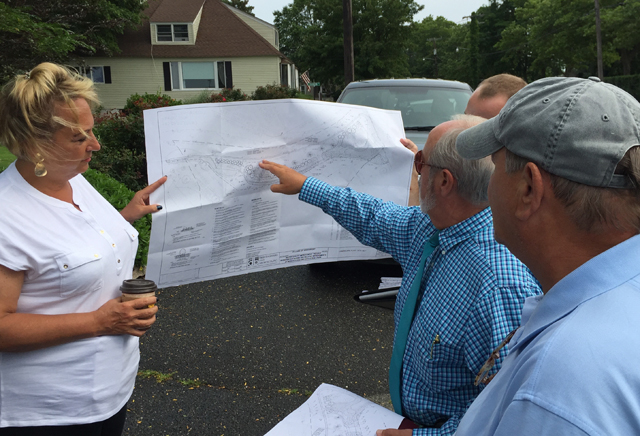Greenport village administrator Paul Pallas points to the drainage swale plans. (Credit: Grant Parpan)