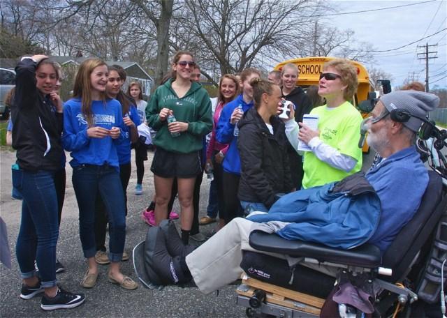 Event volunteer Barbara Brown of West Babylon talks to the Riverhead High School students who joined the walk to Town Hall.