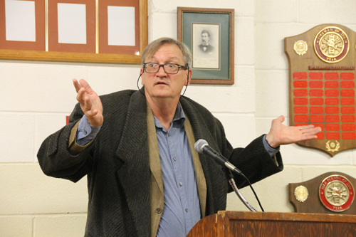 PAUL SQUIRE PHOTO | Michael Osinski, owner of Widow's Hole Oyster Company, responds to shouts from the crowd during a public hearing at the Greenport Village board meeting Monday night.