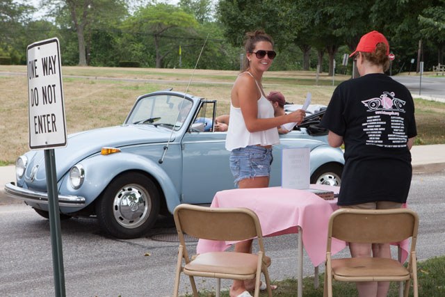 Thea Grenci of Montauk checks in while friends wait in her 1971 VW Super Bug. (Credit: Katharine Schroder)