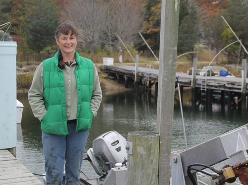 CARRIE MILLER PHOTO   Karen Rivara on the dock at her Southold based oyster business.