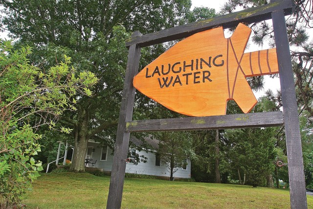 Laughing Waters resident Dennis Gallagher made this wooden sign in 2013. (Credit: Barbaraellen Koch)