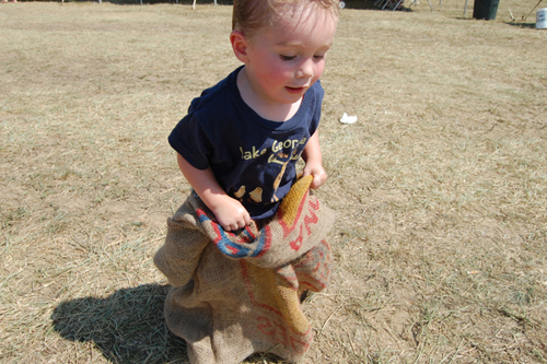 Tyler Smith, 23 months of Baltimore, Maryland competes in a potato sack race. (Credit: Vera Chinese)