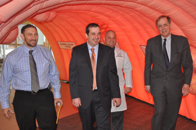 Caption: From left to right, Dr. Brett Ruffo, Dr. Mark Coronel, Dr. George Ruggiero and Dr. James Tomarken show the community what it's like to walk through a 10-foot tall inflatable colon at Peconic Bay Medical Center. (Credit: PBMC)