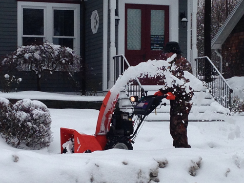 Cleaning up from the storm along Main Street in Greenport. Cyndi Murray photo.