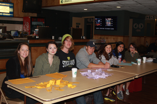 "JENNIFER GUSTAVSON PHOTO | Mattituck seniors taking students' tickets at Mattituck Cinemas. On Monday morning, the school showed ""Bully,"" a 2011 documentary showing how bullying affects teenagers and their families."