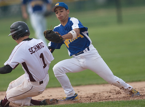 GARRET MEADE PHOTO | Southampton's Wyatt Schmidt is tagged out by Mattituck shortstop Marcos Perivolaris while trying to steal second base in the first inning.