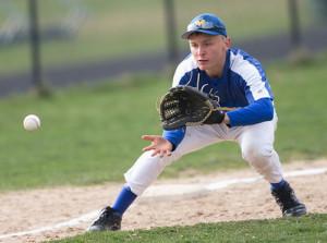 GARRET MEADE PHOTO | Mattituck third base Will Gildersleeve focuses on fielding a ground ball.