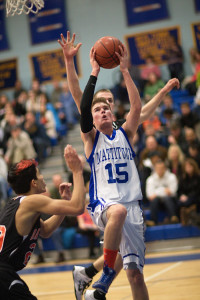 GARRET MEADE PHOTO   Mattituck's Ian Nish, with Babylon's Jacob Carlock behind him and Fernando Vazquez to his right, attacking the basket.