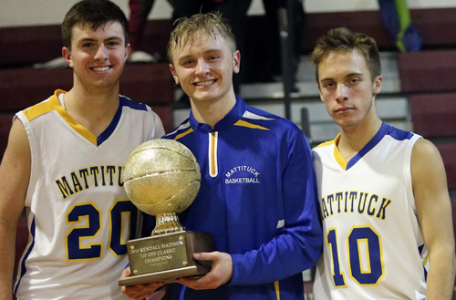 From left, Chris Dwyer, Will Gildersleeve and Joe Tardif with Mattituck's newly won prize. (Credit: Garret Meade)