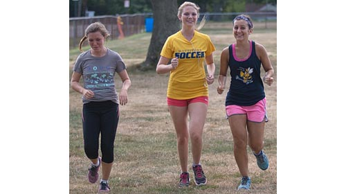 From left, Melanie Pfennig, Kaylee Bergen and Audrey Hoeg are among 10 returning runners for defending county champion Mattituck. (Credit: Garret Meade)