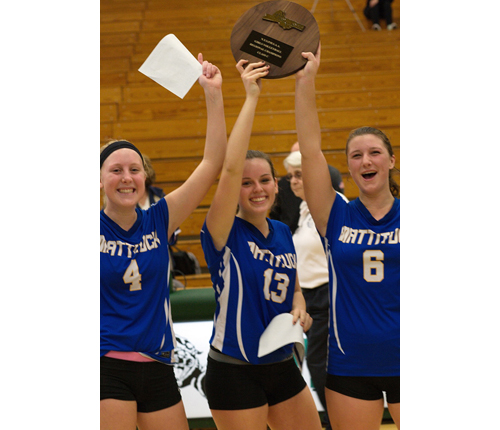 Mattituck's three captains, from left, Colby Prokop, Carly Doorhy and Emilie Reimer picked up the Long Island Class C championship plaque, the Tuckers' fourth in five years. (Credit: Garret Meade)