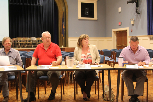 From left, Doug Cooper, Jeff Smith, Laura Jens-Smith and Jerry Diffley. Ms. Jens-Smith was elected president at Thursday's Mattituck school board meeting. (Credit: Jen Nuzzo)