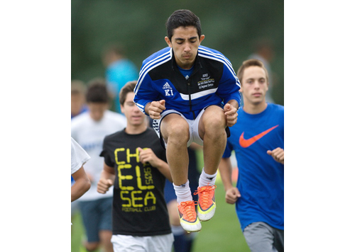 GARRET MEADE PHOTO | Kaan Ilgin during a conditioning drill at Mattituck's first practice on Monday.
