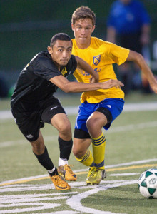 GARRET MEADE PHOTO | Central Islip's Osman Portillo Jr., left, and Mattituck's Paul Hayes pursuing the ball.