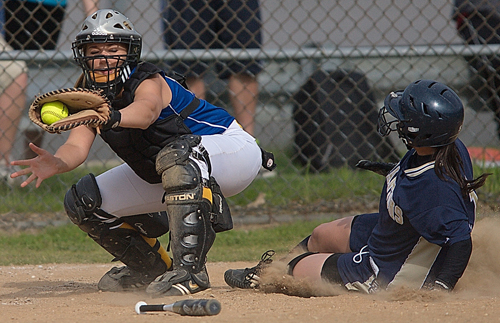 GARRET MEADE FILE PHOTO | Mattituck catcher Brittany Tumulty, shown receiving a throw in a game against Bayport-Blue Point in 2011, has rejoined the team after a one-year sabbatical.