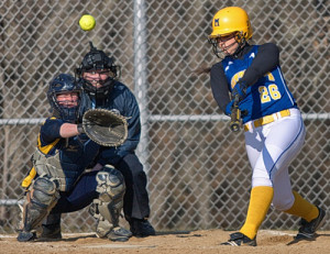 GARRET MEADE PHOTO | Brittany Tumulty of Mattituck making contact on a pitch from Shoreham-Wading River's Chelsea Hawks.