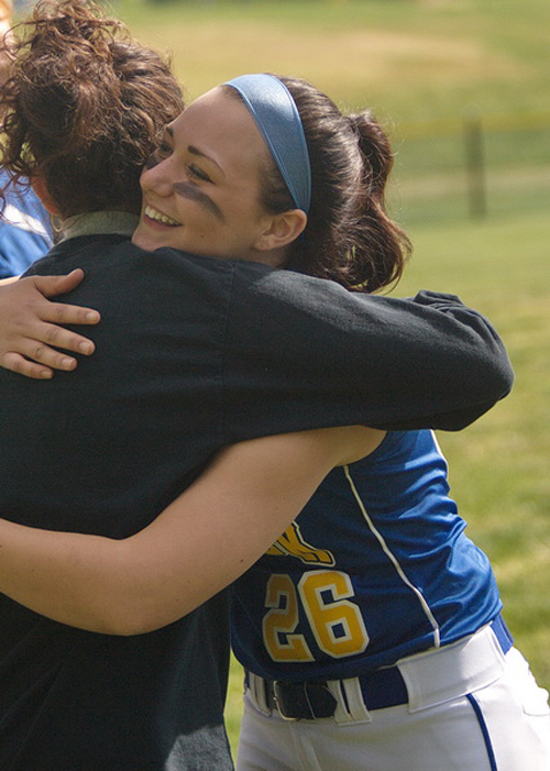 GARRET MEADE PHOTO | One of Mattituck's seven seniors, catcher Brittany Tumulty, hugs coach Kelly Pickering during a pregame Senior Day ceremony.