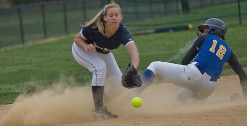 GARRET MEADE PHOTO | Stony Brook's Hannah Abrahamsen covered third base, but Mattituck's Melissa Siegfried was safe on the play.