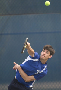 GARRET MEADE PHOTO | Mattituck junior Charles Hickox serving during his first doubles match against Bayport-Blue Point.
