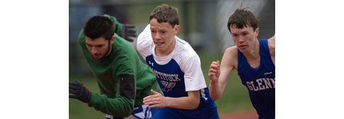 Mattituck's Adam Hicks, center, took second place in the 3,200 meters in 11 minutes 50 seconds. (Credit: Garret Meade)