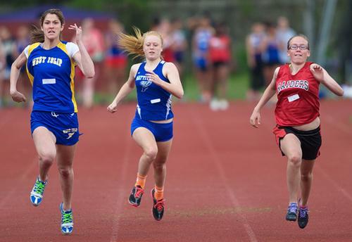 GARRET MEADE PHOTO | Mattituck's Sarah Goerler, center, competing in the 100 meters in the Hampton Invitational.
