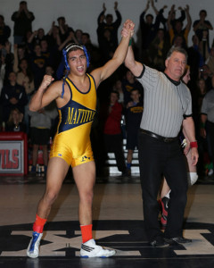 DANIEL DE MATO PHOTO | Bobby Becker's left arm is raised after winning the county title at 138 pounds. He dedicated his season to his mother Susan, who was recently diagnosed as having leukemia.