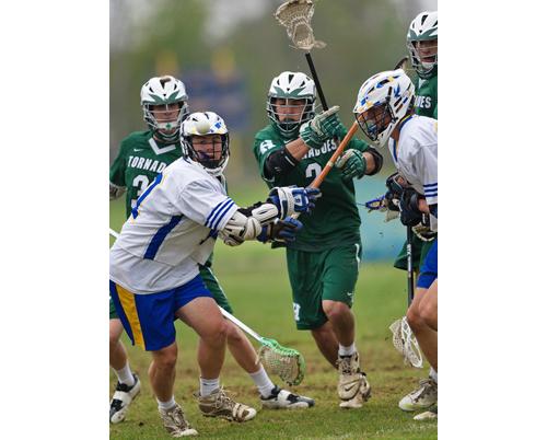 GARRET MEADE PHOTO | Mattituck/Greenport/Southold's Connor Stumpf, far left, and Harborfields' John Malico, center, battle for a loose ball.