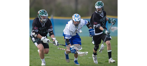 The chase is on for a ground ball. From left, Westhampton Beach's Evan Gagne, left, and Wyatt Sommer join Mattituck/Greenport/Southold's Dylan Marlborough in pursuit of the ball. (Credit: Garret Meade)